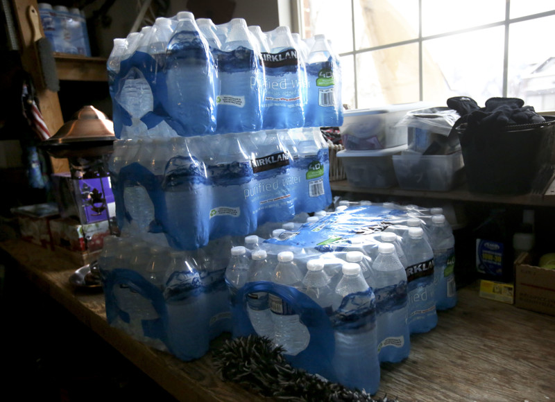 Packages of bottled water are pictured at the home of Kathe Bolan in Sandy on Thursday, March 14, 2019. Bolan's water is contaminated with elevated levels of lead and copper.