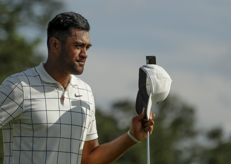 Tony Finau reacts after finishing on the 18th hole during the third round for the Masters golf tournament Saturday, April 13, 2019, in Augusta, Ga. (AP Photo/Chris Carlson)