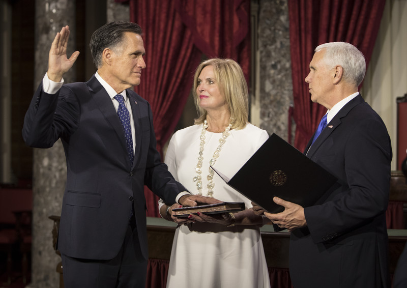 Senator Mitt Romney, R-Utah, with wife Ann holding the Bible, is sworn into office by Vice President Mike Pence in the Old Senate Chamber in the U.S. Capitol in Washington, D.C., on January 3, 2019.