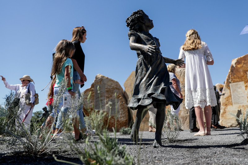 People tour the Children's Pioneer Memorial at This Is the Place Heritage Park in Salt Lake City after its dedication on Saturday, July 20, 2019.
