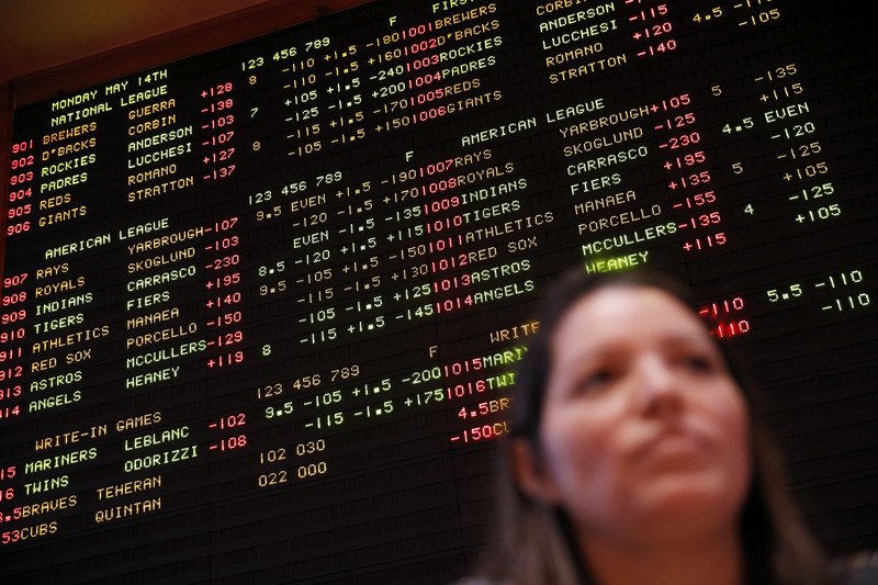 A board displays odds behind Aracely Geraci in the sports book at the South Point hotel-casino, Monday, May 14, 2018, in Las Vegas. The Supreme Court on Monday gave its go-ahead for states to allow gambling on sports across the nation, striking down a federal law that barred betting on football, basketball, baseball and other sports in most states. (AP Photo/John Locher)