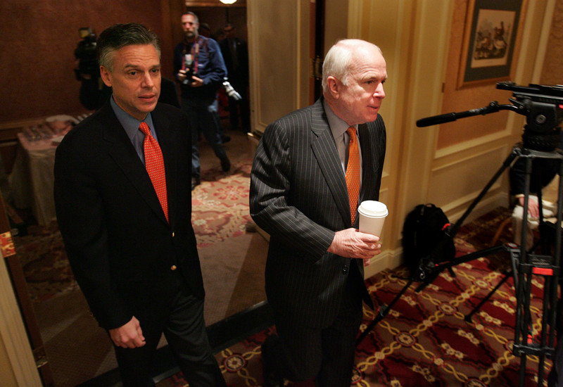 Utah Gov. Jon Huntsman and Arizona Sen. John McCain enter the a reception room at Grand America Hotel in Salt Lake City on March 2, 2007.