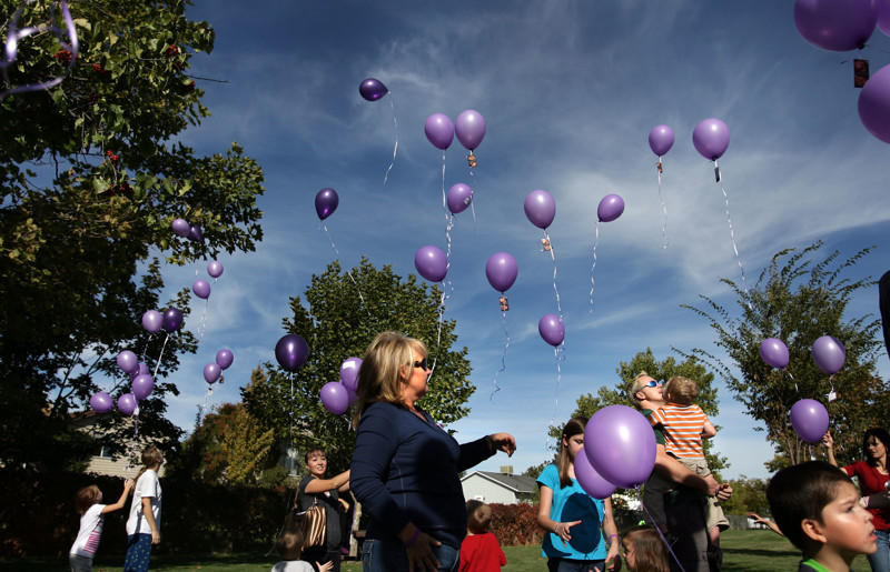 Purple balloons are released in honor of Susan Powell's 30th birthday at West View Park in West Valley on Saturday, October 15, 2011.