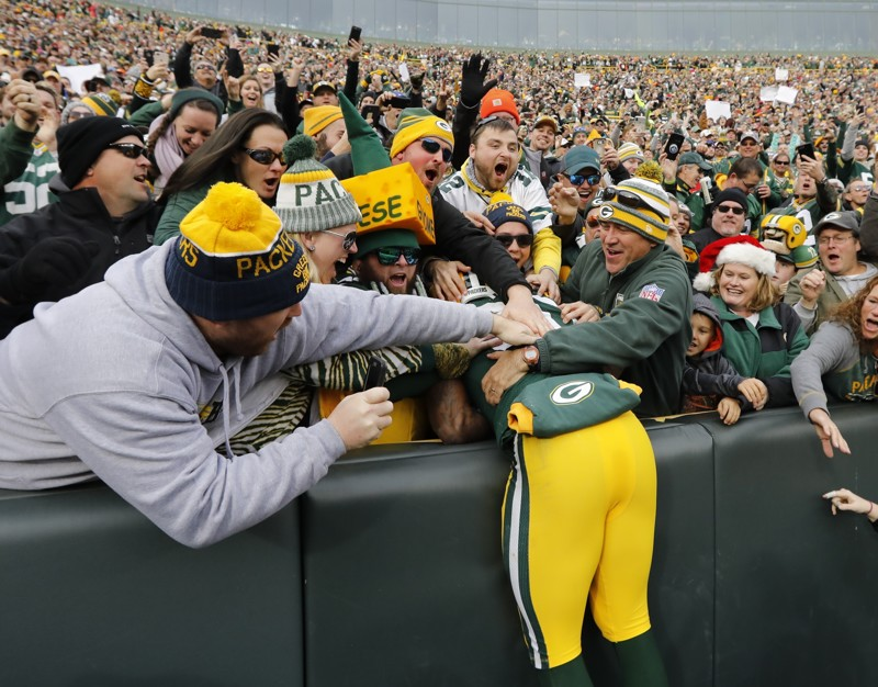 Green Bay Packers' Jamaal Williams celebrates with fans after running for a touchdown against the Tampa Bay Buccaneers Sunday, Dec. 3, 2017, in Green Bay, Wis.