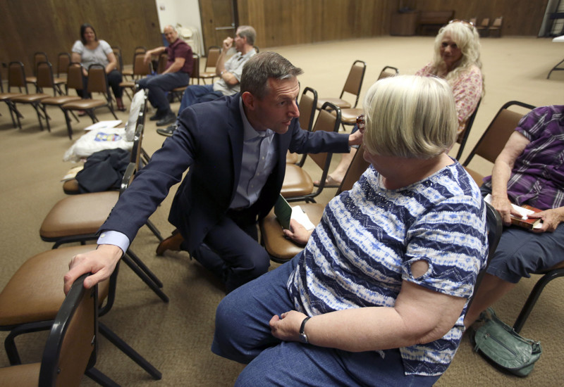 State Rep. Mike Kennedy, R-Alpine, talks with Valerie Massey while campaigning for the U.S. Senate at the Payson Senior Citizen Center in Payson on Friday, June 8, 2018.