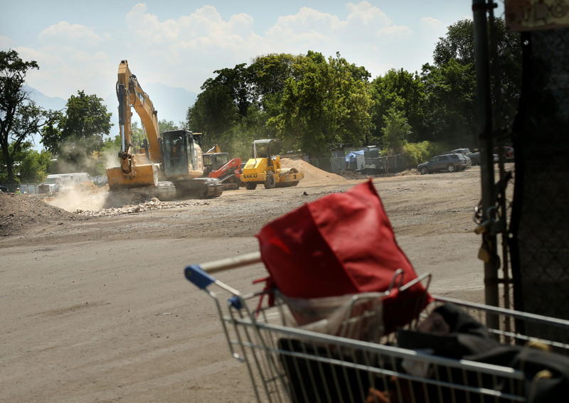 A shopping cart and its contents are abandoned at the entrance of a homeless shelter construction site at 275 High Ave. in Salt Lake City on Thursday, July 26, 2018.