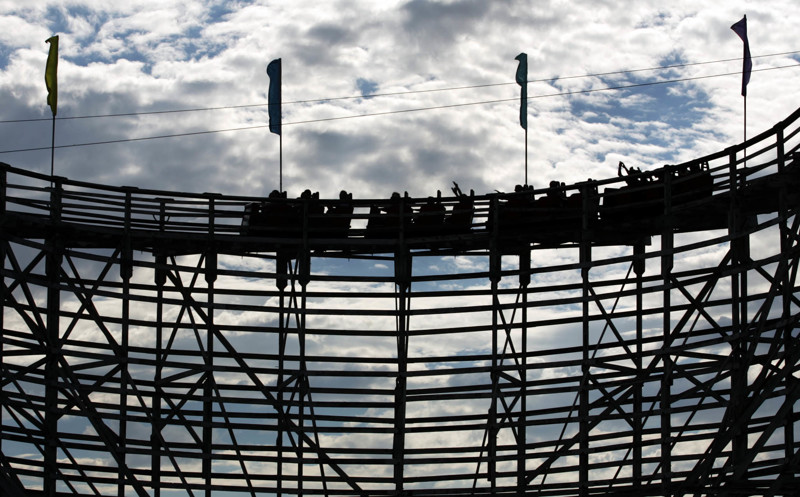 Thrill seekers make the first turn on the wooden roller coaster at the Lagoon Amusement Park in Farmington Saturday, July 30, 2005.