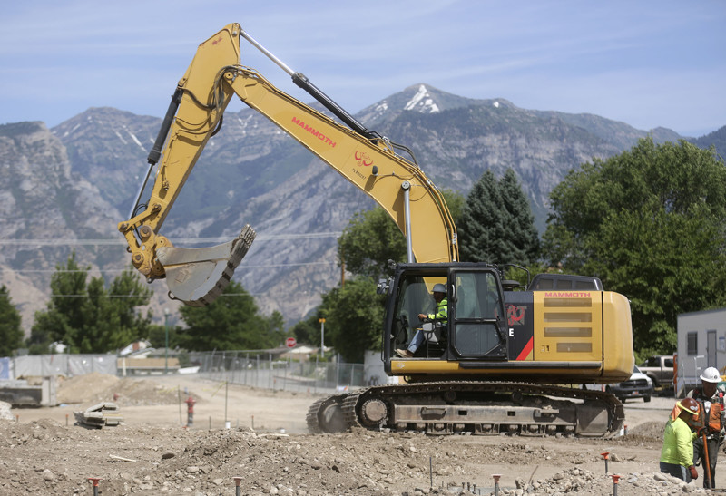 Construction workers build a student housing complex next to Utah Valley University in Orem on Wednesday, July 17, 2019.