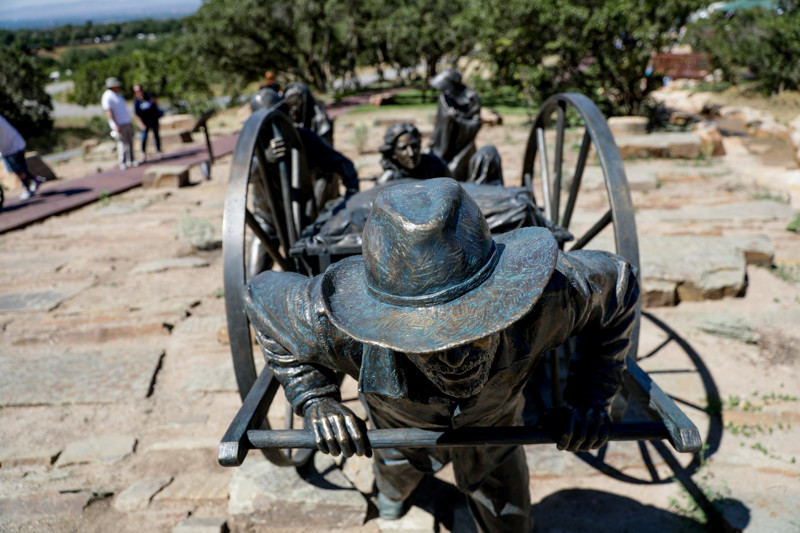 A sculpture depicts a handcart team at the Children's Pioneer Memorial at This Is the Place Heritage Park in Salt Lake City on the day of the memorial's dedication, Saturday, July 20, 2019.