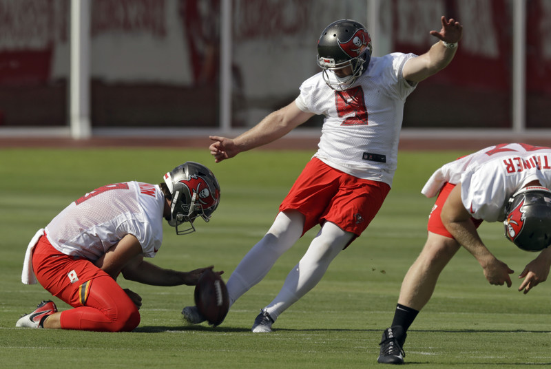 Tampa Bay Buccaneers' Matt Gay kicks a field goal as Bradley Pinion holds during an NFL football minicamp Thursday, June 6, 2019, in Tampa, Fla.
