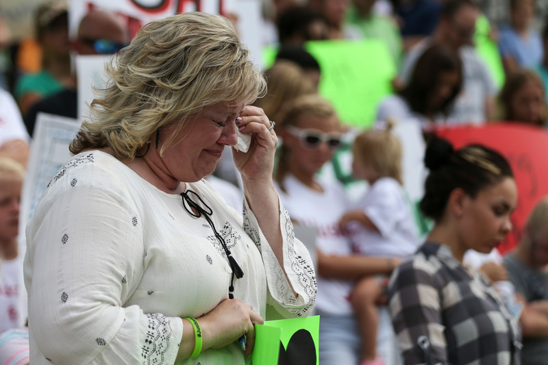 FILE - Laurie Holt, mother of Josh Holt, cries during a prayer at a rally the Utah State Capitol in Salt Lake City on Saturday, July 30, 2016. Family members and supporters held a rally to call for the release of Josh Holt, who has been jailed in Venezuela.