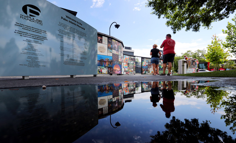 Visitors look at memorials left at the Pulse nightclub in Orlando, Florida on Sunday, June 9, 2019.