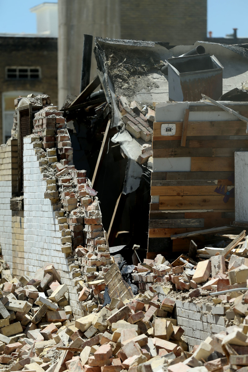 An unreinforced masonry building located on First Avenue in Salt Lake City is demolished on Wednesday, July 3, 2019. The building recently collapsed as a result of rain pressure on the roof.