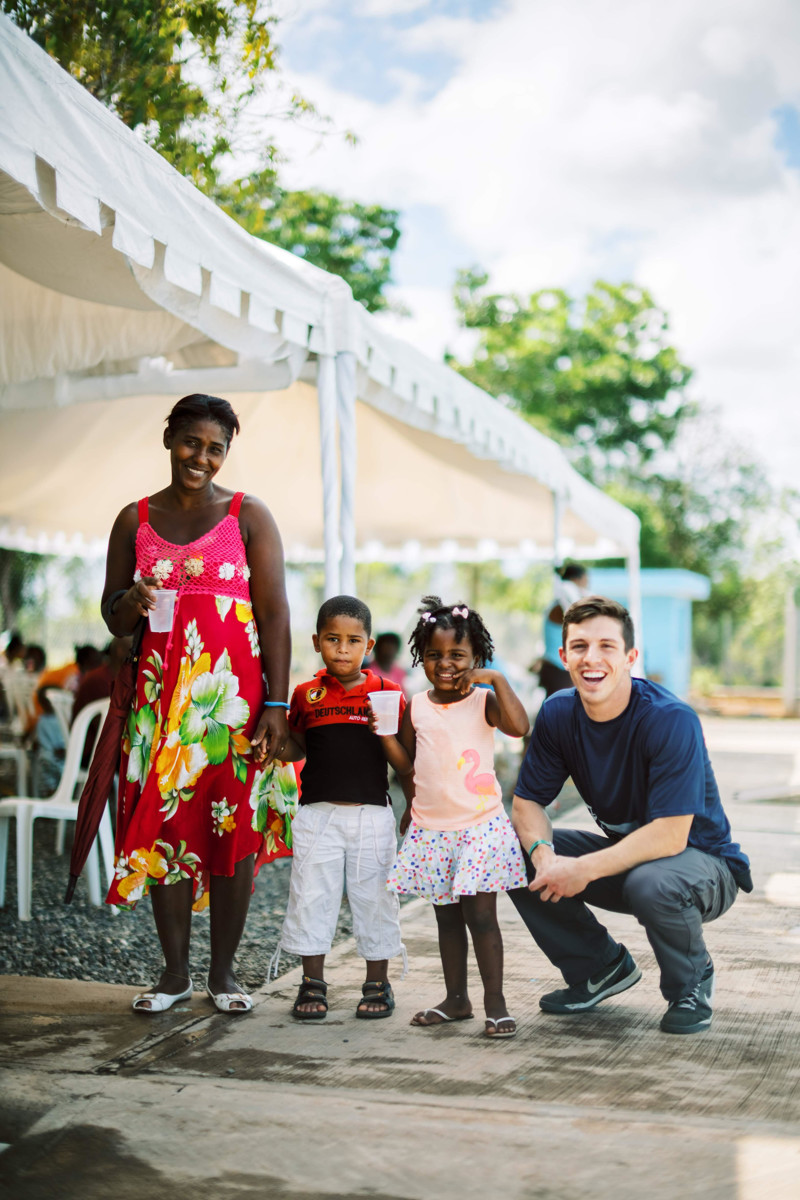 Talon Hatch, right, of the Community of Hope Foundation, on the ground in the Dominican Republic where the foundation supports a clinic and school.