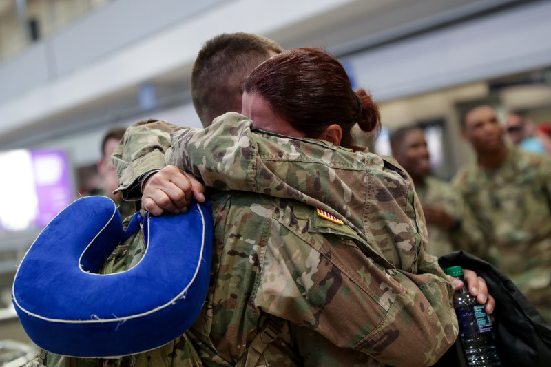 Sgt. Nicholas Welty, left, hugs his wife, Sgt. 1st Class Valerie Welty, at the Salt Lake City International Airport on Thursday, July 19, 2018. Both were deployed to different locations with the U.S. Army Reserve's 478th Human Resources Company for nine months in the Middle East and returned home Thursday.