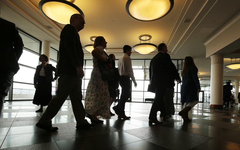 Attendees walks through the Conference Center before the start of the Saturday afternoon session of the 189th Annual General Conference of The Church of Jesus Christ of Latter-day Saints in Salt Lake City on Saturday, April 6, 2019.