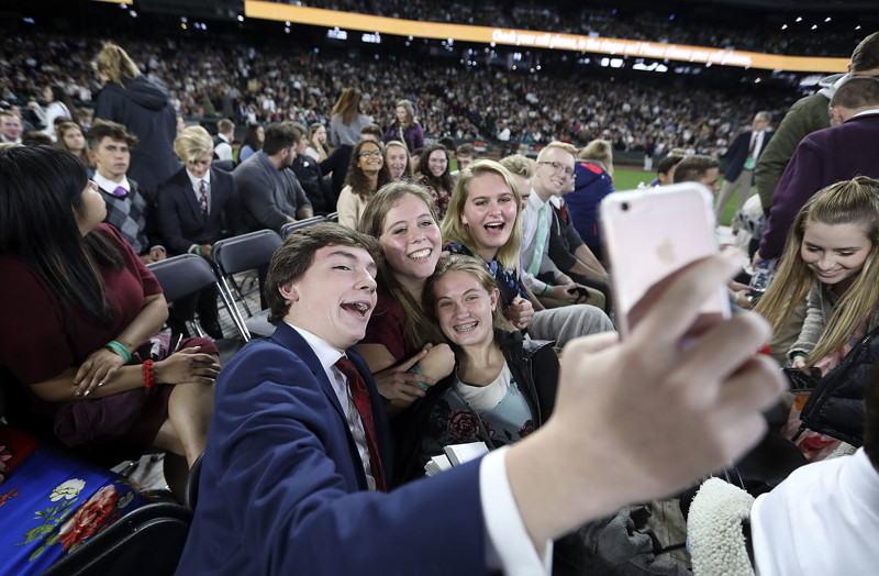Cole Edmonds, Stephanie Woods, Kylie Larreau and Grace Williams take a selfie while waiting for President Russell M. Nelson, of The Church of Jesus Christ of Latter-day Saints, to speak at Safeco Field in Seattle, Wash., on Saturday, Sept. 15, 2018.