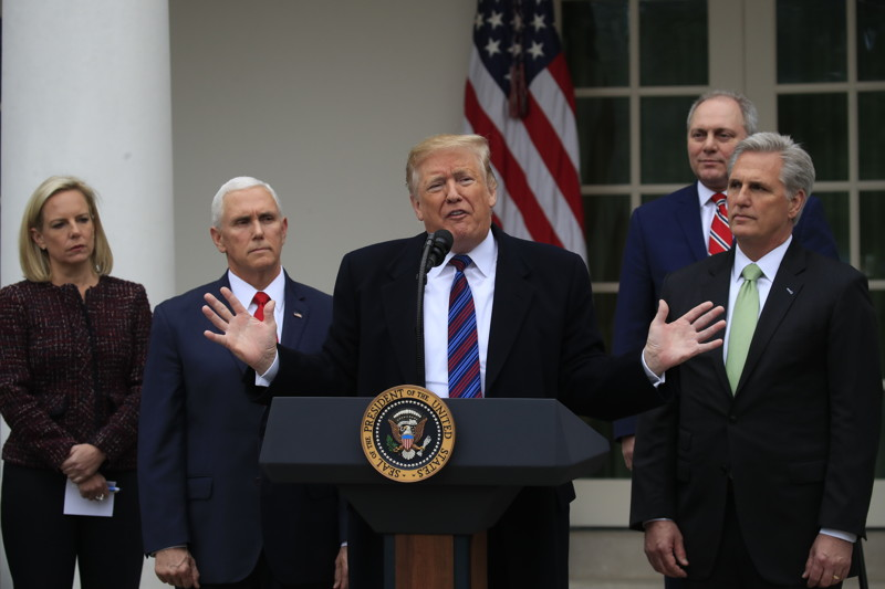 President Donald Trump speaks in the Rose Garden of the White House in Washington, after a meeting with Congressional leaders on border security, as the government shutdown continues Friday, Jan. 4, 2019, as Homeland Security Secretary Kirstjen Nielsen, Vice President Mike Pence, House Minority Whip Steve Scalise of La., and House Minority Leader Kevin McCarthy of Calif., listen.