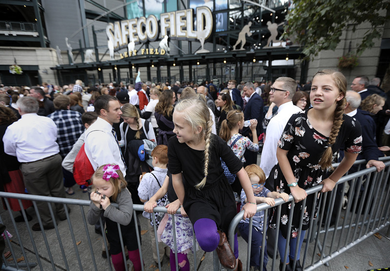 Finley Roberts and Avery Roberts wait for the gates to open to hear President Russell M. Nelson of The Church of Jesus Christ of Latter-day Saints speak at Safeco Field in Seattle, Wash., on Saturday, Sept. 15, 2018.