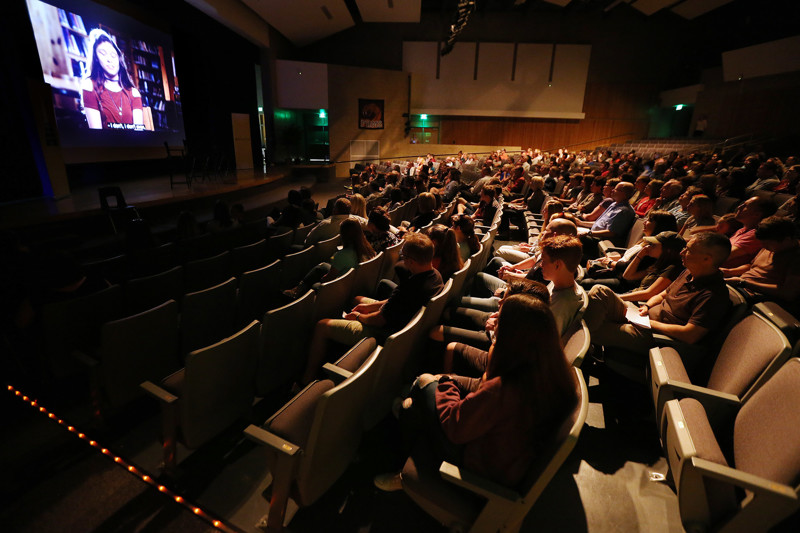 Audience members watch during a screening of the movie