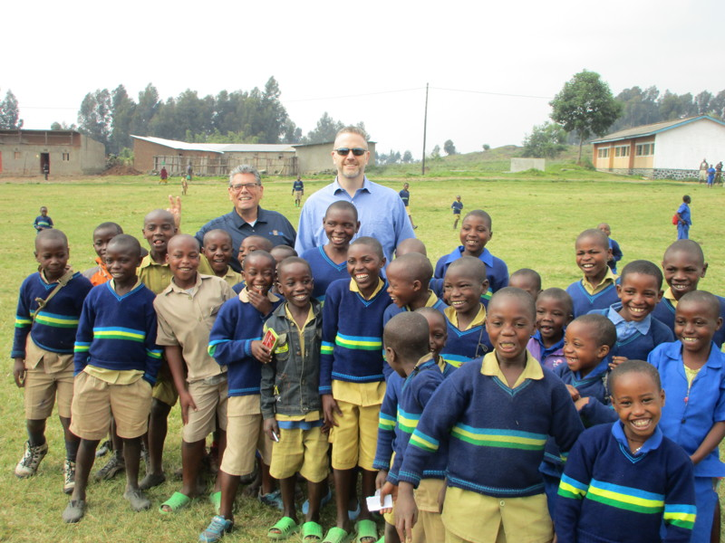 Joseph Carbone, back left, and Dr. Don Lyon are pictured during an Eye Care 4 Kids humanitarian trip to Rwanda.