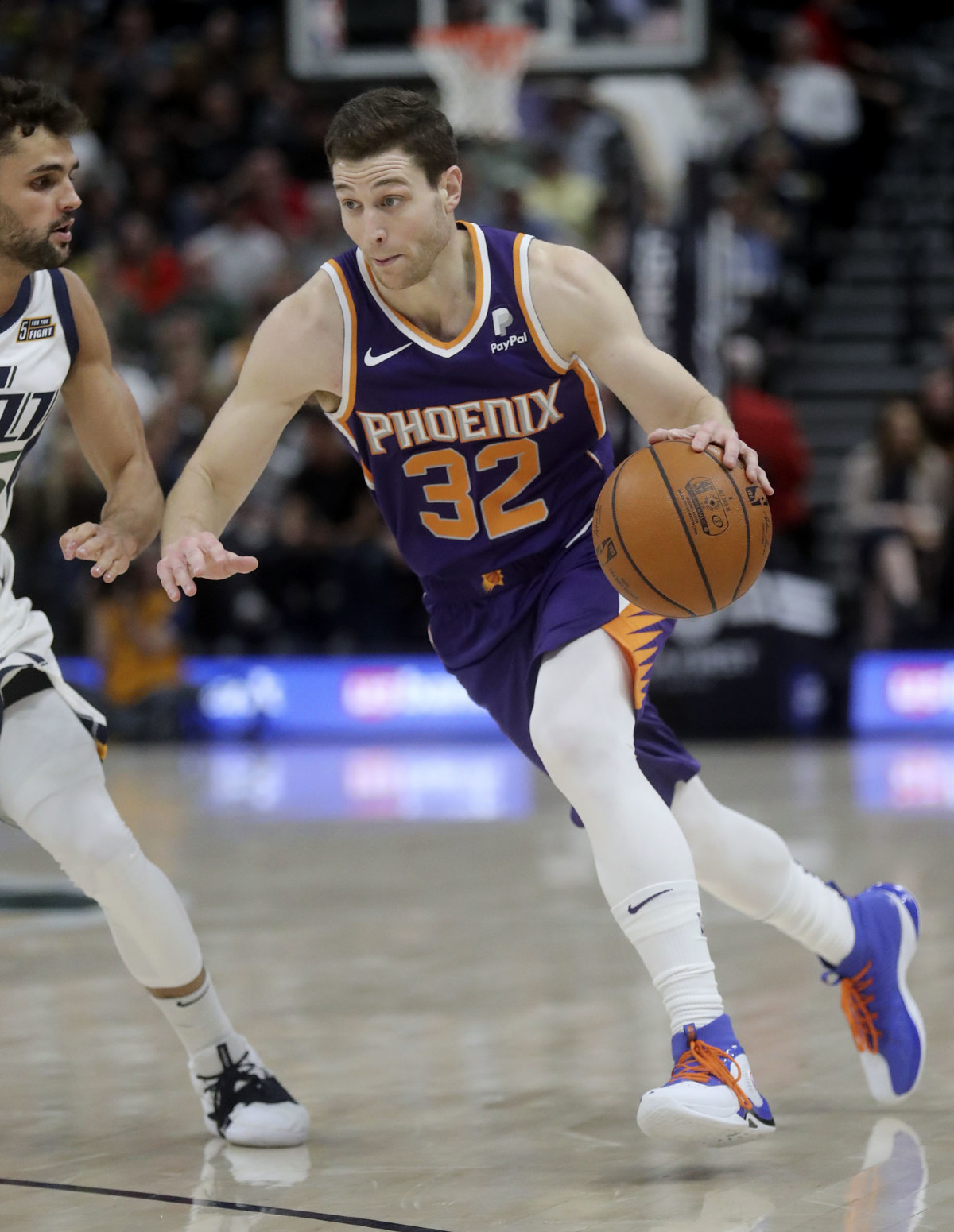 b281c1978f5 Phoenix Suns guard Jimmer Fredette (32) dribbles around Utah Jazz guard  Raul Neto (25) during an NBA basketball game at the Vivint Smart Home Arena  in Salt ...