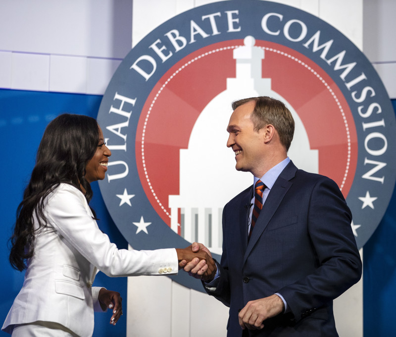 FILE - U.S. Rep. Mia Love and Salt Lake County Mayor Ben McAdams shake hands as they take part in a debate at the Gail Miller Conference Center at Salt Lake Community College on Monday, Oct. 15, 2018, in Sandy, Utah, as the two battle for Utah's 4th Congressional District.
